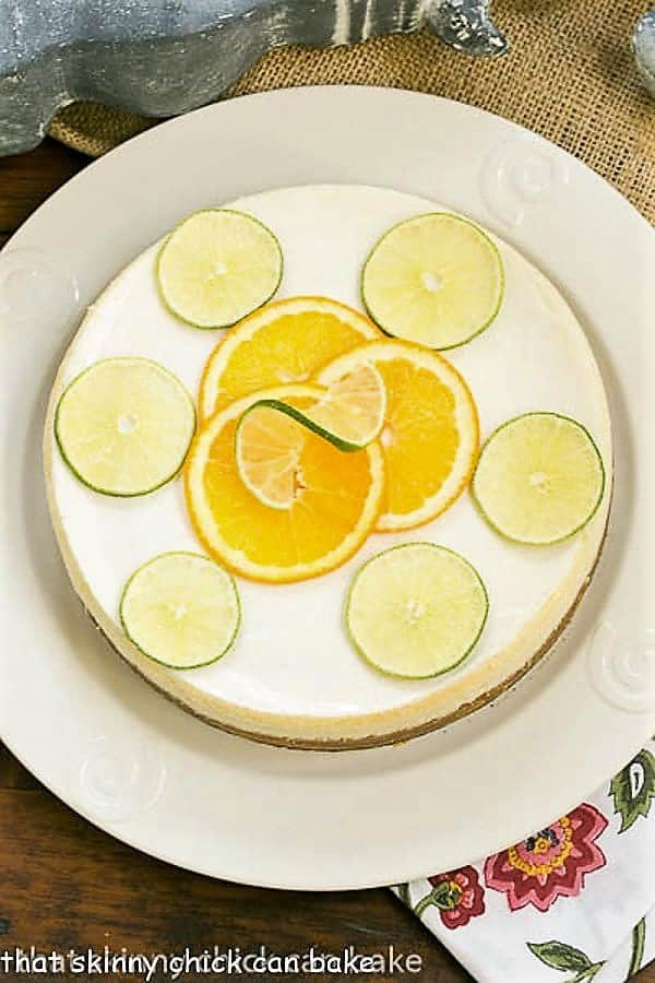 Margarita Cheesecake overhead view garnished with citrus slices