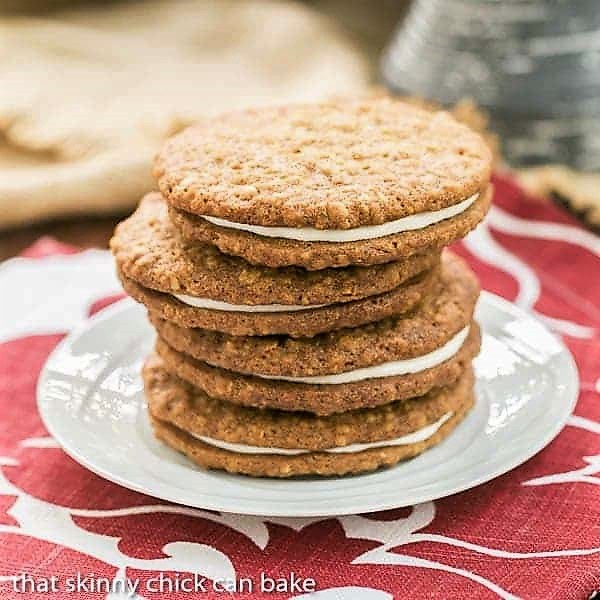 Four Oatmeal Creme Pies stacked on a white plate