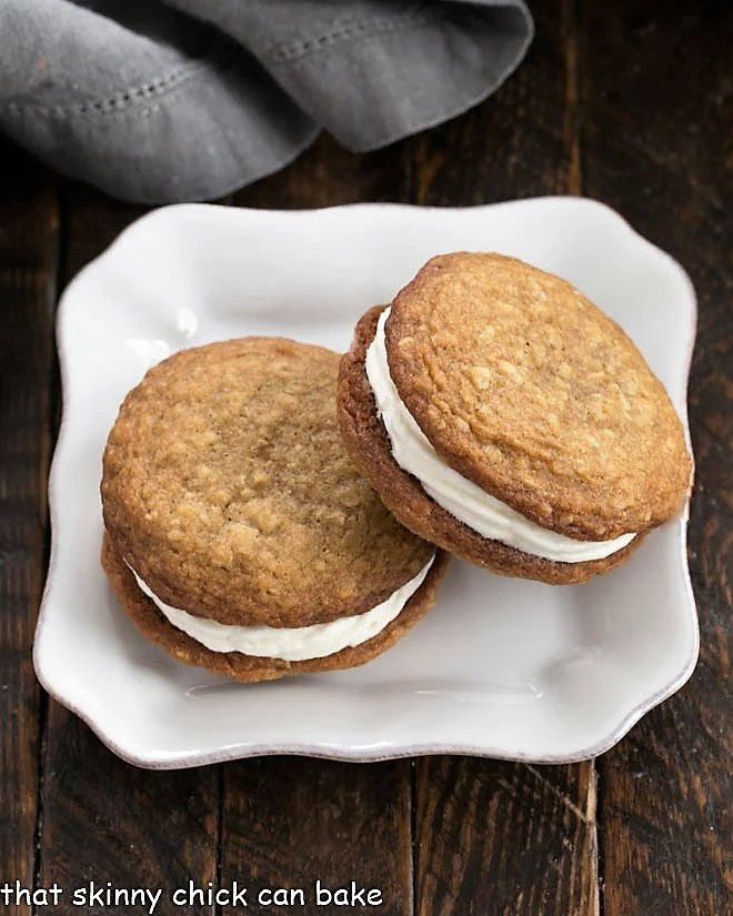Overhead view of 2 Oatmeal Creme Pies on a square white plate