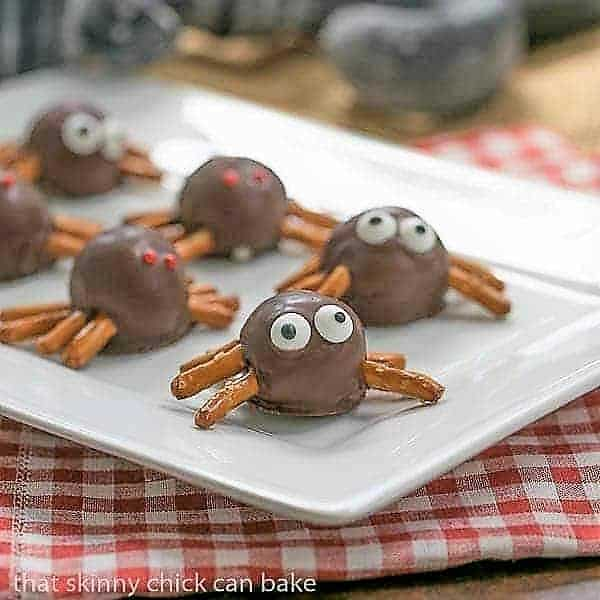 Potato Candy Spiders on a white rectangular tray