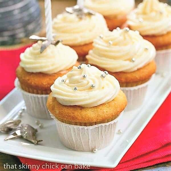 Vanilla Cupcakes with Cream Cheese Frosting on a white tray