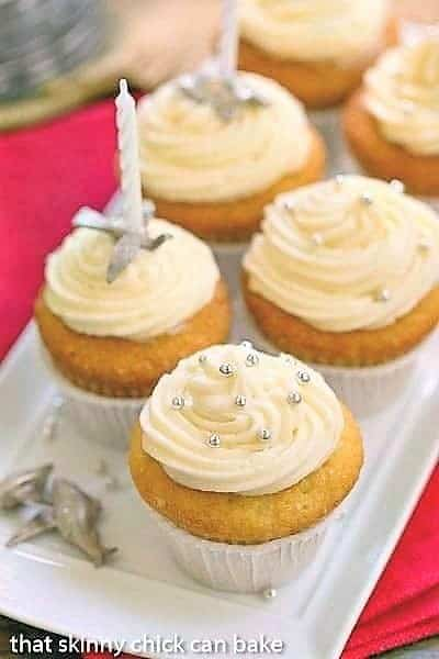Vanilla Cupcakes with Cream Cheese Frosting on a white tray with candles