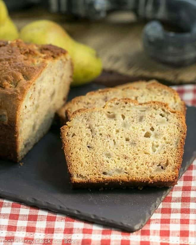 Sour Cream Pear Bread slices on a slate cutting board