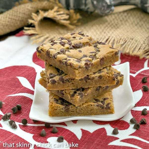 Chocolate Chip Topped Butterscotch Bars stacked on a small white plate