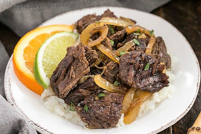 Cuban Shredded beef on a small white plate