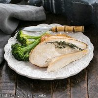 Plate of broccoli and homemade rotisserie chicken with a bamboo handle fork