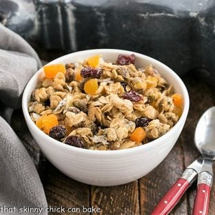 Pistachio Coconut Granola with 2 red handled spoons