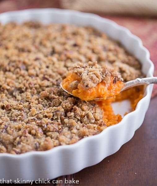 Praline Topped Sweet Potato Casserole in a shallow white dish