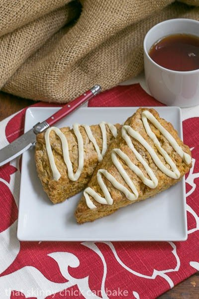 Overhead view of Pumpkin Scones on a white plate with a red handle knife