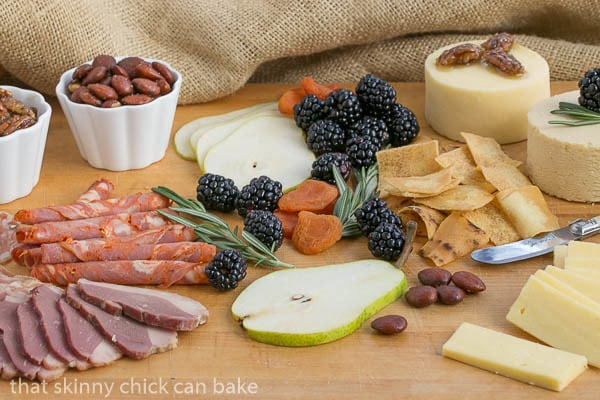 Charcuterie Platter with fruit, meats, nuts, cheeses and crackers