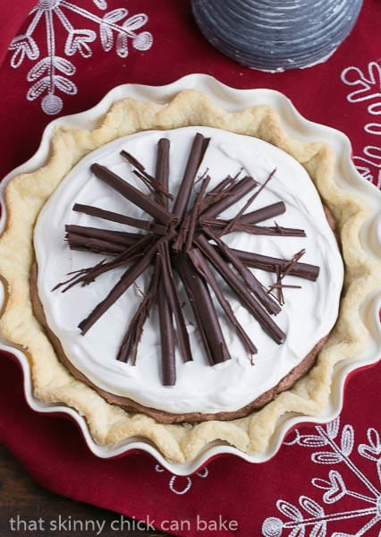 Overhead view of Black Bottom Chocolate Mousse Pie on a red and white cloth