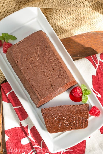 Chocolate Terrine with Raspberry Sauce on a white serving tray