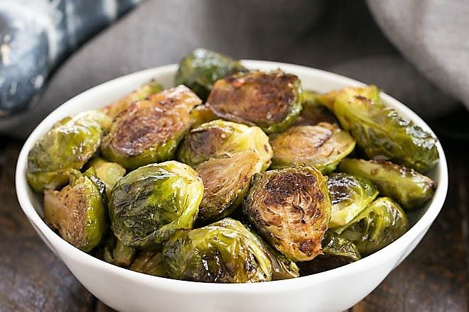 Oven Roasted Brussels Sprouts in a small white ceramic bowl