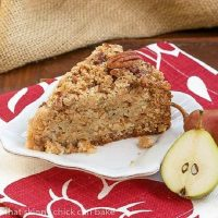 A slice of pear coffee cake on a square white plate