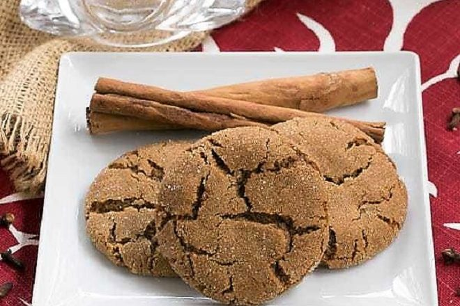 Triple Ginger Snaps with cinnamon sticks on a square white plate