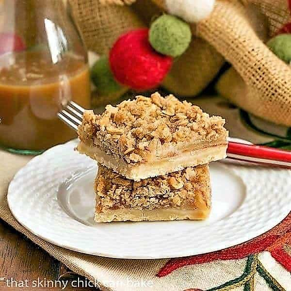 Apple Streusel Bars stacked on a white basketweave plate