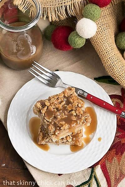 Caramel Apple Streusel Bars on a white ceramic plate with a red handled fork