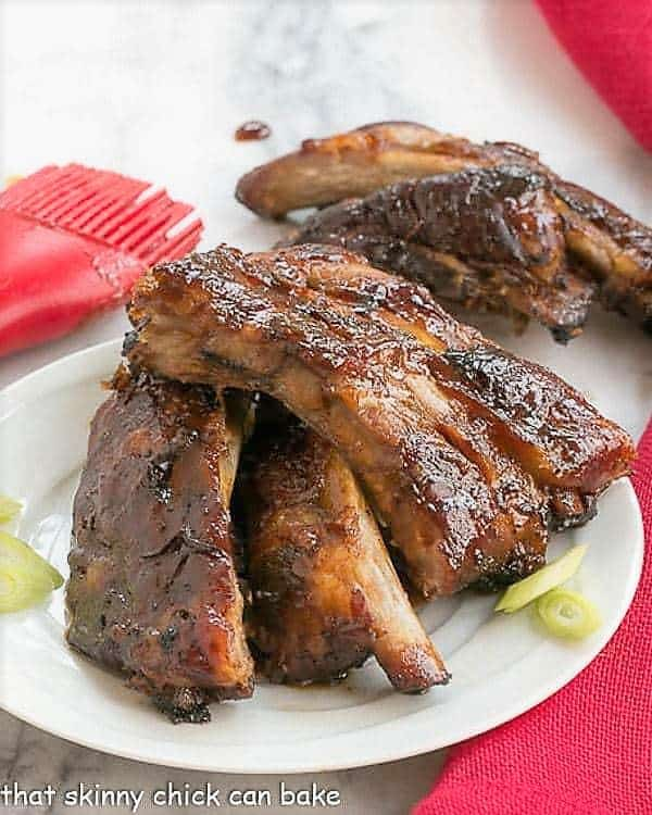 Asian Baby Back Ribs on a small white plate with some thin scallion slices