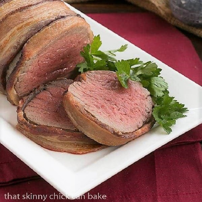 Two slices of beef tenderloin warpped in bacon