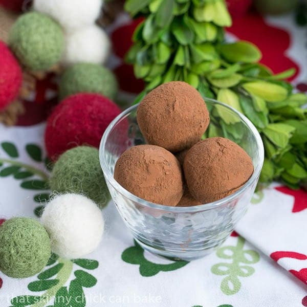 Caramel Filled Chocolate Truffles in a glass candy dish