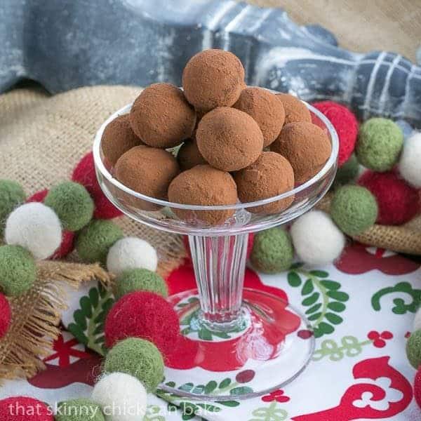 Caramel Filled Chocolate Truffles piled on a glass pedestal