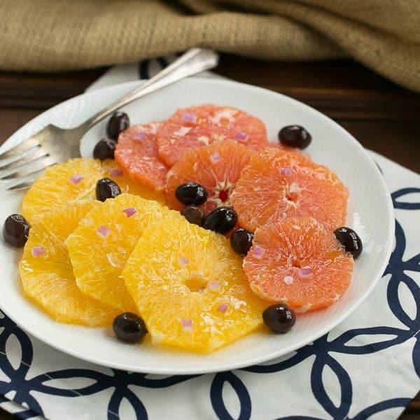 Oranges for a Orange Olive Salad on a white plate