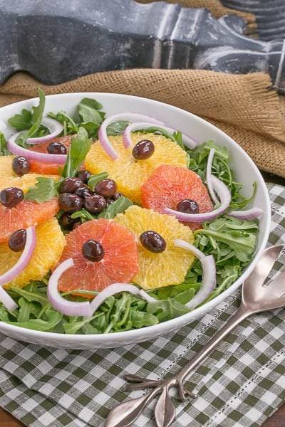 Orange Olive Salad in a white bowl on a checked napkin