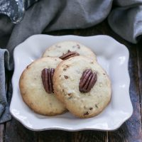 Homemade Pecan Sandies Cookies on a square white plate