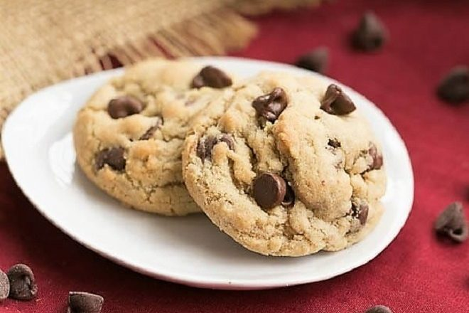 2 rum chocolate chip cookies on a white oval plate