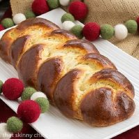 beautiful loaf of Swiss Butter Braid (Butterzopf) on a white platter