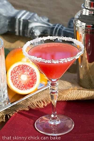 Blood Orange Margaritas in a martini glass on a red napkin