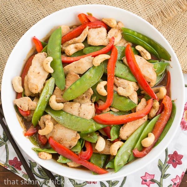 Overhead view of stir fried Cashew Chicken in a white serving bowl