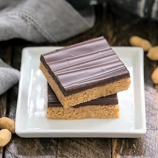 Homemade Reese's Bars on a square white plate