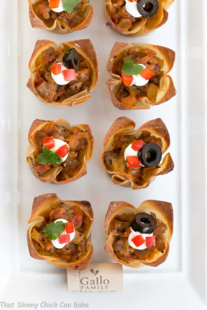 Overhead view of Mini Mexican Tarts on a white ceramic tray