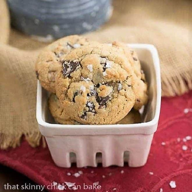 Salted Toffee Chocolate Chunk Cookies in a square ceramic dish