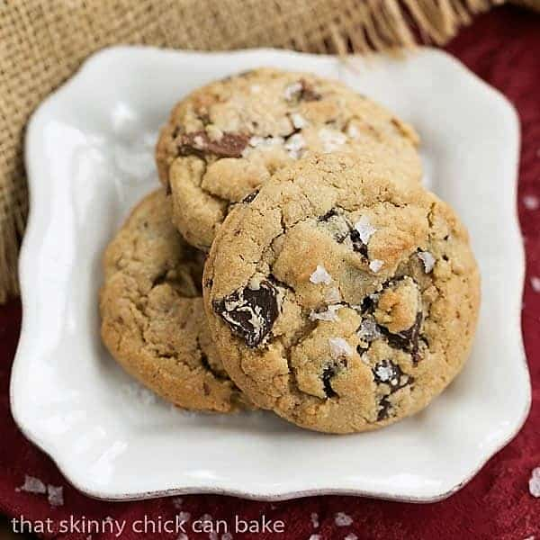 Salted Toffee Chocolate Chunk Cookies on a square white plate