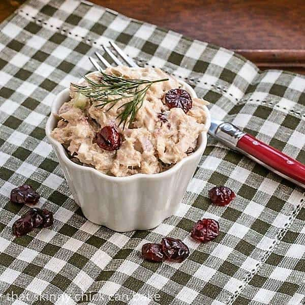 Tuna, Cranberry, Pecan Salad Sandwich in a small white ramekin
