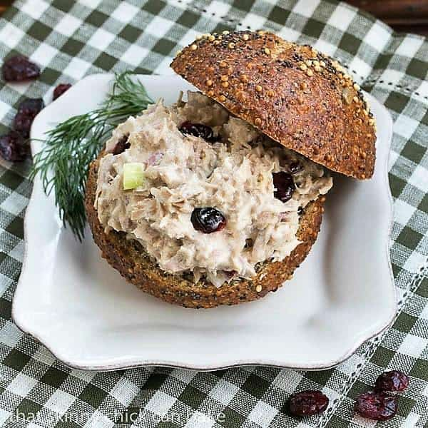 Tuna, Cranberry, Pecan Salad Sandwich on a white plate