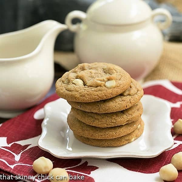 A stack of white chocolate macadamia nut cookies on a square white plate