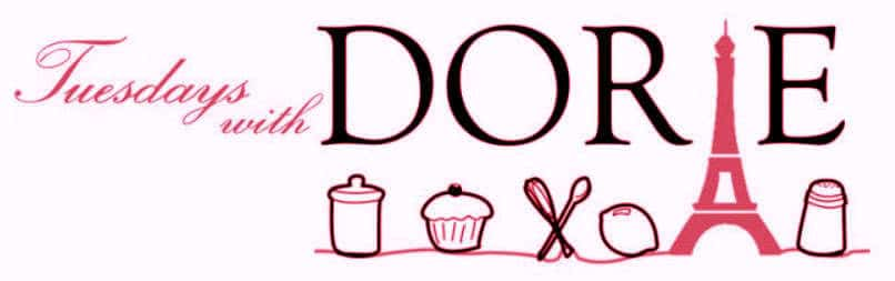 Tuesdays with Dorie logo in black and pink lettering with a cupcake, spoons, lemon, Eiffel tower and more