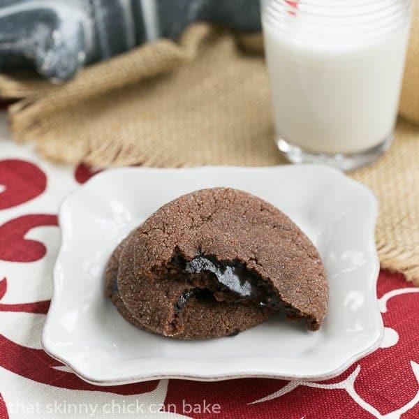 Chocolate Lava Cookies broken in half to expose fudge filling
