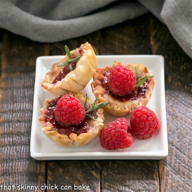 Raspberry Brie Bites  on a white a square whiteplate