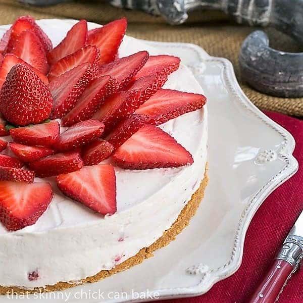 Strawberry Vanilla Cream Pie close view of half the pie on a serving dish