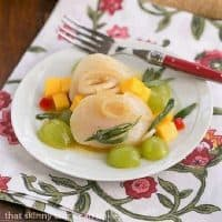 Winter Ceviche on a small white plate over a floral napkin
