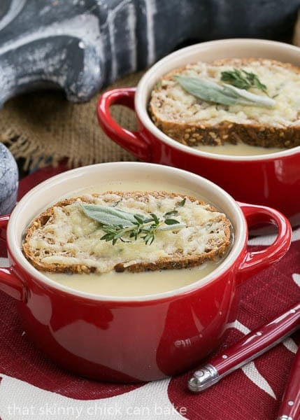 Hangover Soup topped with cheesy toasts and herbs