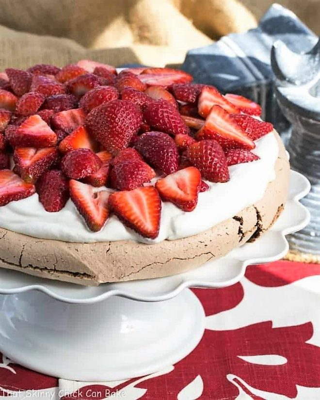 Strawberry Topped Chocolate Pavlova on a white cake stand