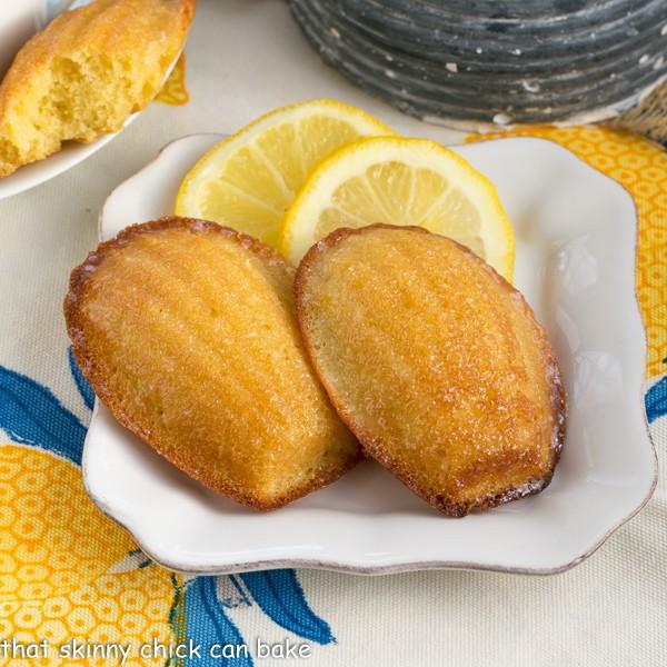 Lemon Madeleines on a square white ceramic plate