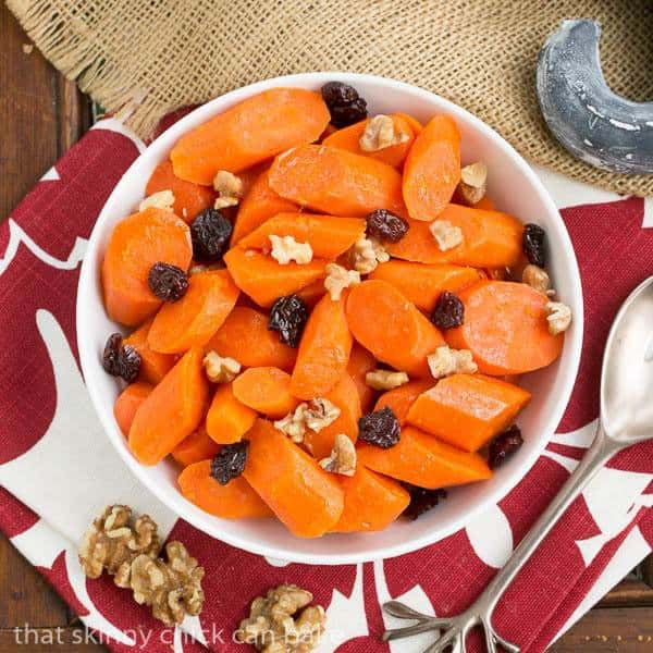 Overhead view of Orange Glazed Carrots - Carrots with a sweet orange glaze, walnuts and dried cranberries