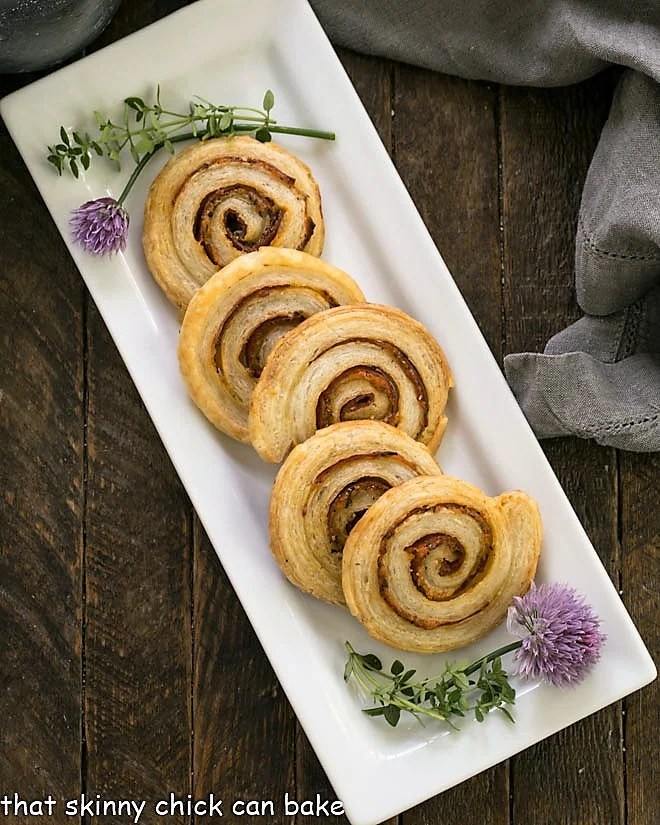 overhead view of pepperoni pinwheels on a white ceramic tray