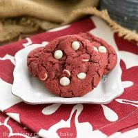 Red Velvet Cookies with White Chocolate Chips on a square white plate over a red and white napkin